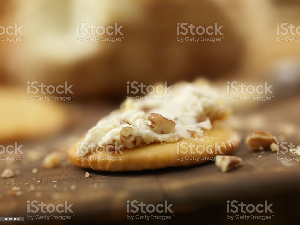 Cream Cheese and Pecans Spread on a Cracker royalty-free stock photo
