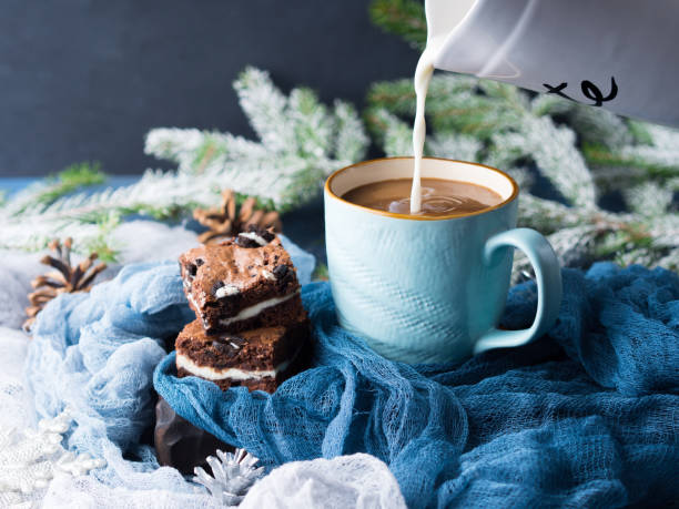 Cream cheese brownies and coffee with milk stock photo