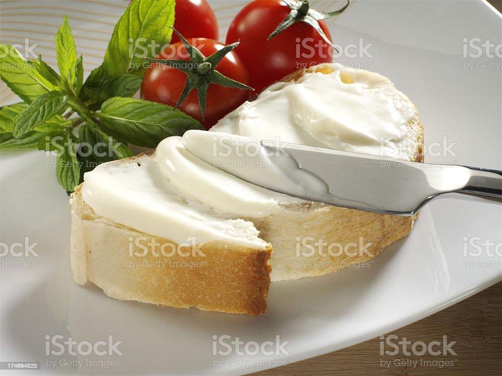 cream cheese on bread stock photo