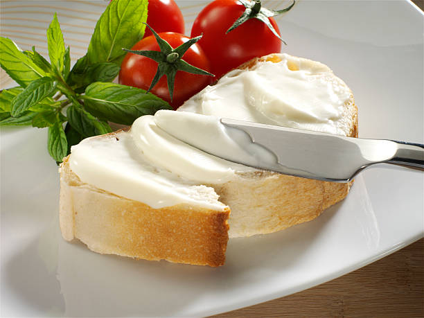 cream cheese on bread stock photo