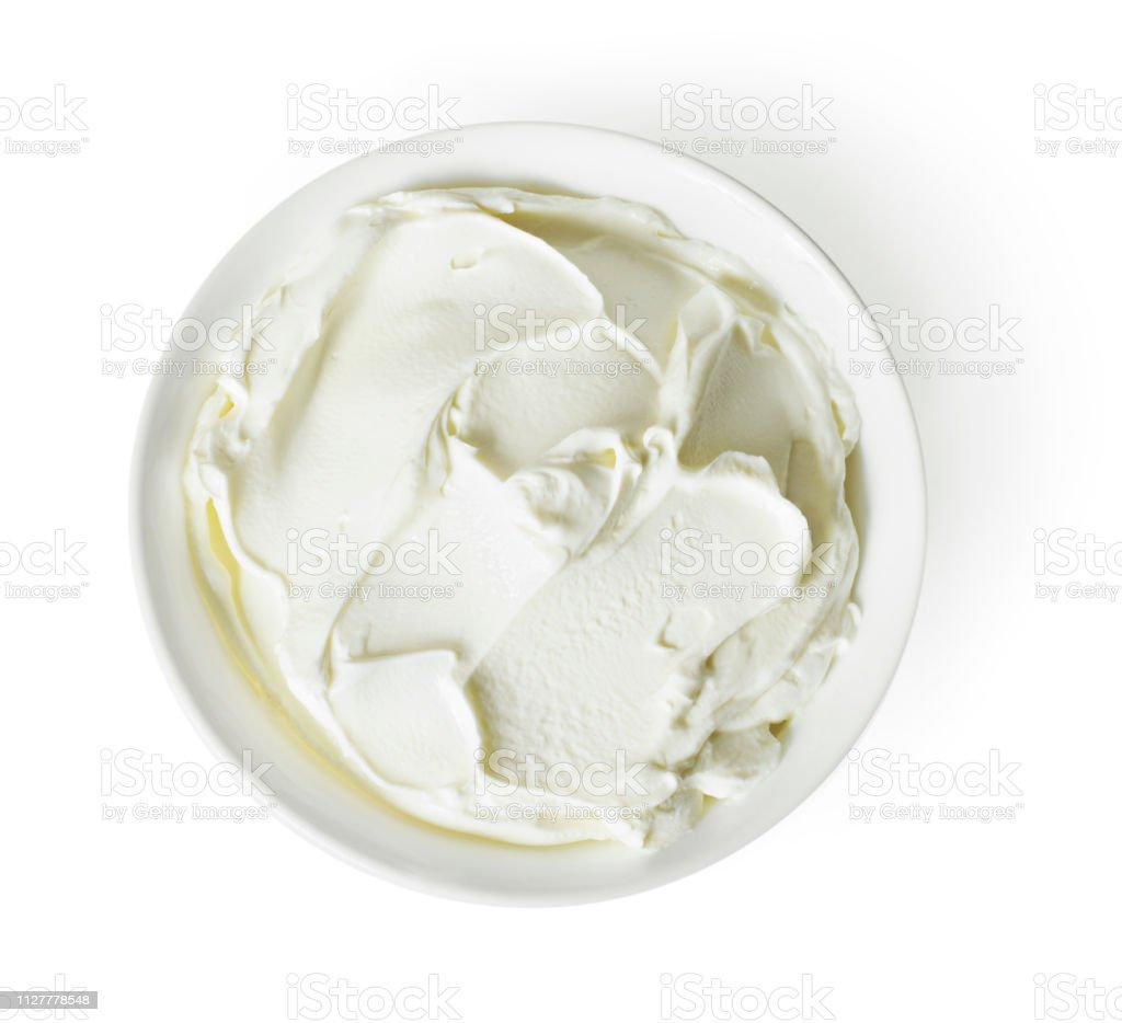 Cream cheese, quark or yogurt in a white bowl stock photo
