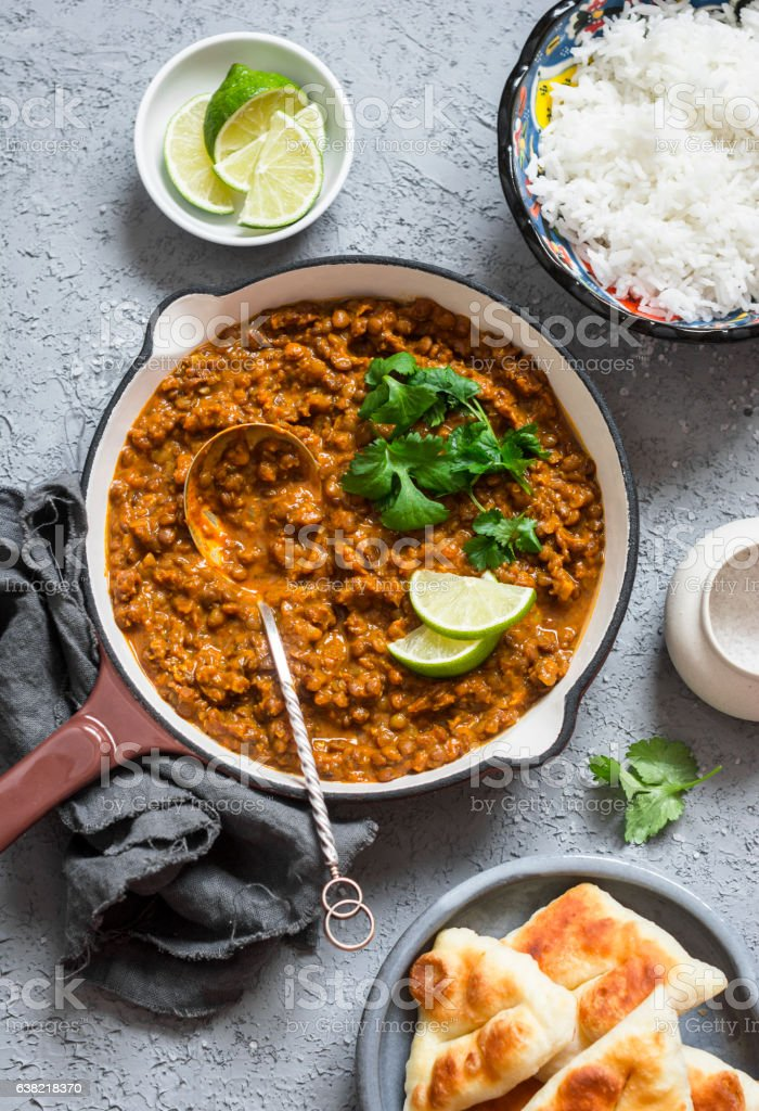 Cream coconut lentil curry, rice, naan bread - vegetarian lunch stock photo