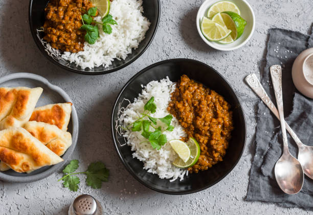 cream coconut lentil curry with rice and naan bread - カレー ストックフォトと画像