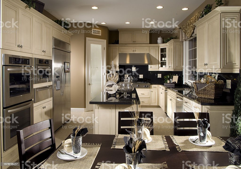 Cream colored kitchen with stainless steal appliances royalty-free stock photo
