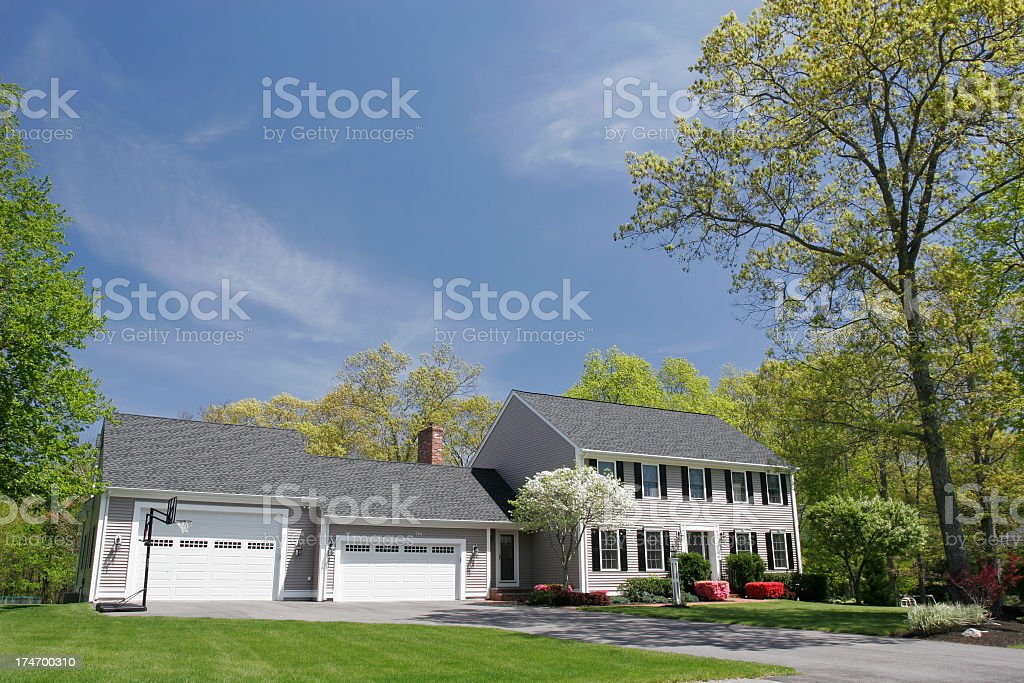 Cream colored single family house with two garages stock photo