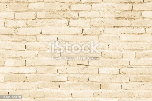 Cream colors and brown brick wall art concrete or stone texture background in wallpaper limestone abstract paint to flooring and homework/Brickwork or stonework clean grid uneven interior rock old.