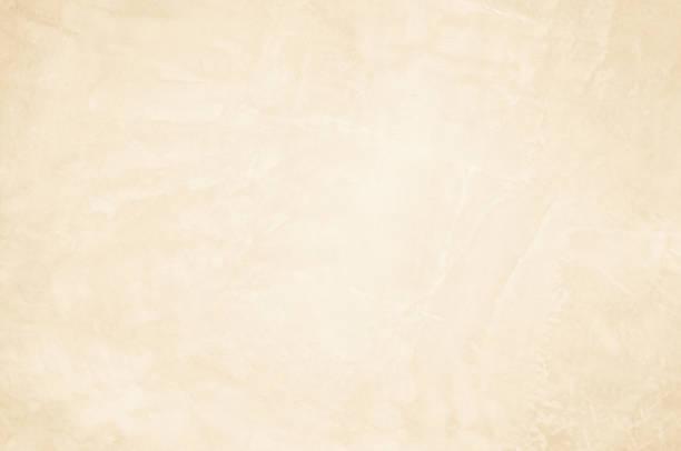 kremowe betonowe tło ścienne. - beżowy zdjęcia i obrazy z banku zdjęć