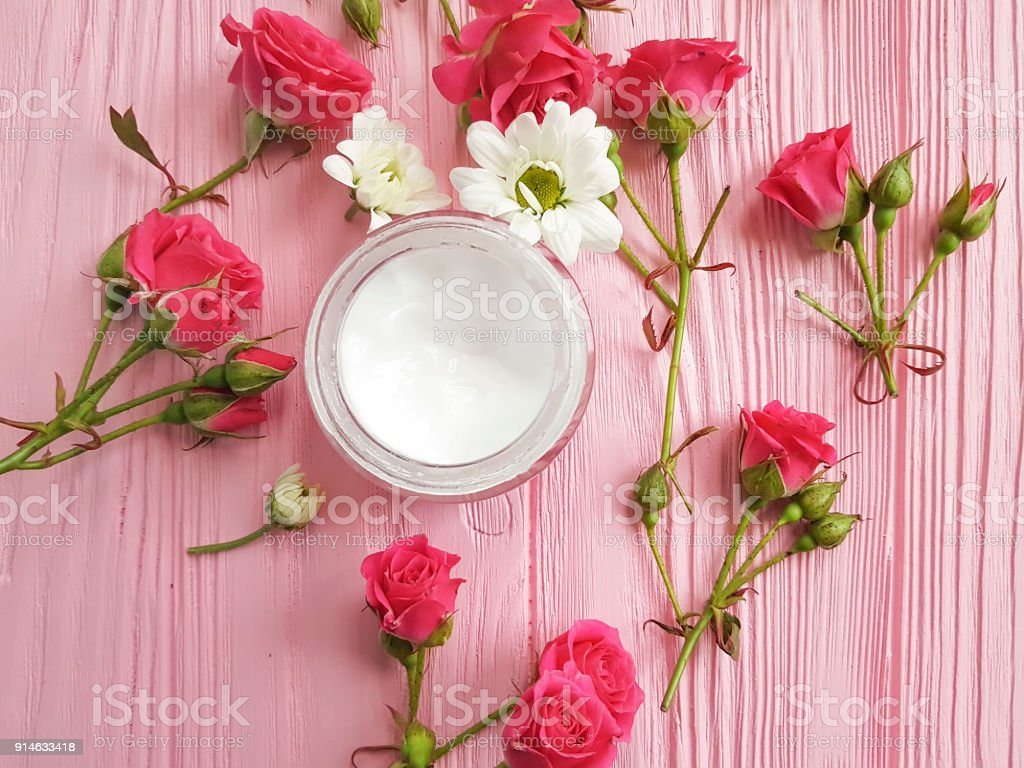cream cosmetic pink wooden rose