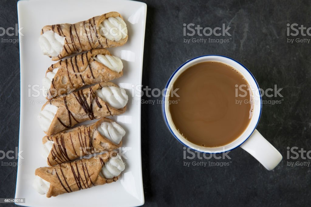 Cream Filled Pastries and Tea royalty-free stock photo