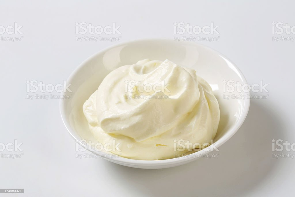 Cream in a porcelaine bowl stock photo
