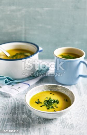 Cream of potato and leek soup with turmeric, topped with fresh parsley