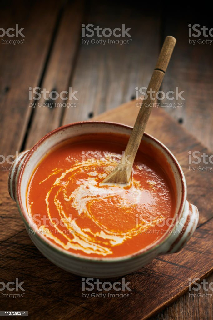 Cream of Tomato Soup topped with a swirl of cream. stock photo