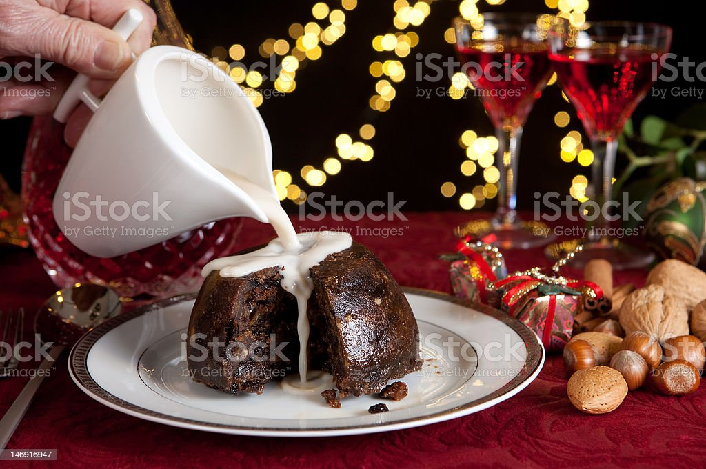 Cream on a christmas pudding stock photo