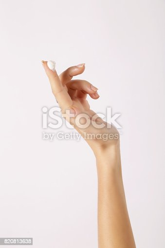 istock Cream on a woman's index finger 820813638