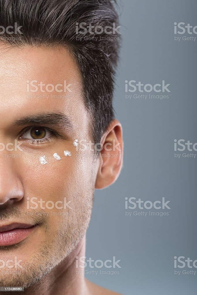 Cream on man's face stock photo