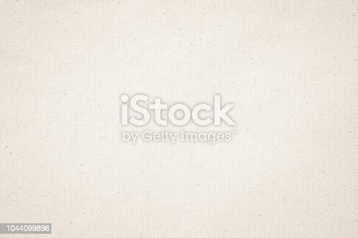 istock Cream Pastel abstract Hessian or sackcloth fabric or hemp sack texture background. Wallpaper of artistic wale linen canvas. Blanket or Curtain of cotton pattern with copy space for text decoration. 1044099896