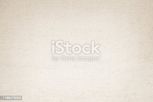 1044099896 istock photo Cream Pastel abstract Hessian or sackcloth fabric or hemp sack texture background. Wallpaper of artistic wale linen canvas. Blanket or Curtain of cotton pattern with copy space for text decoration. 1169475003