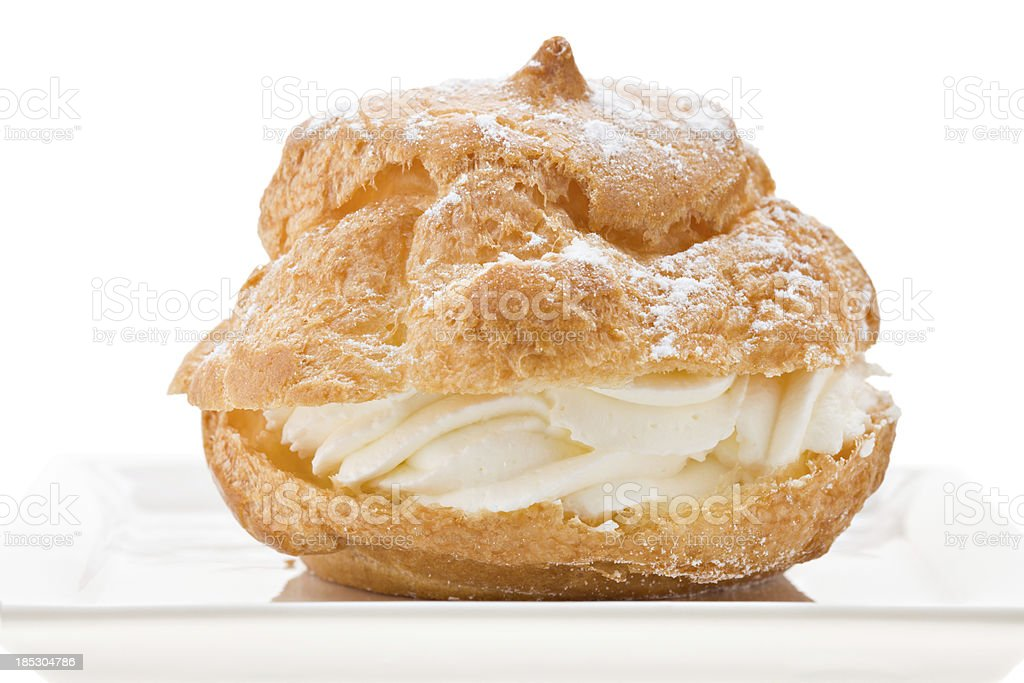 Cream Puff On A White Plate stock photo