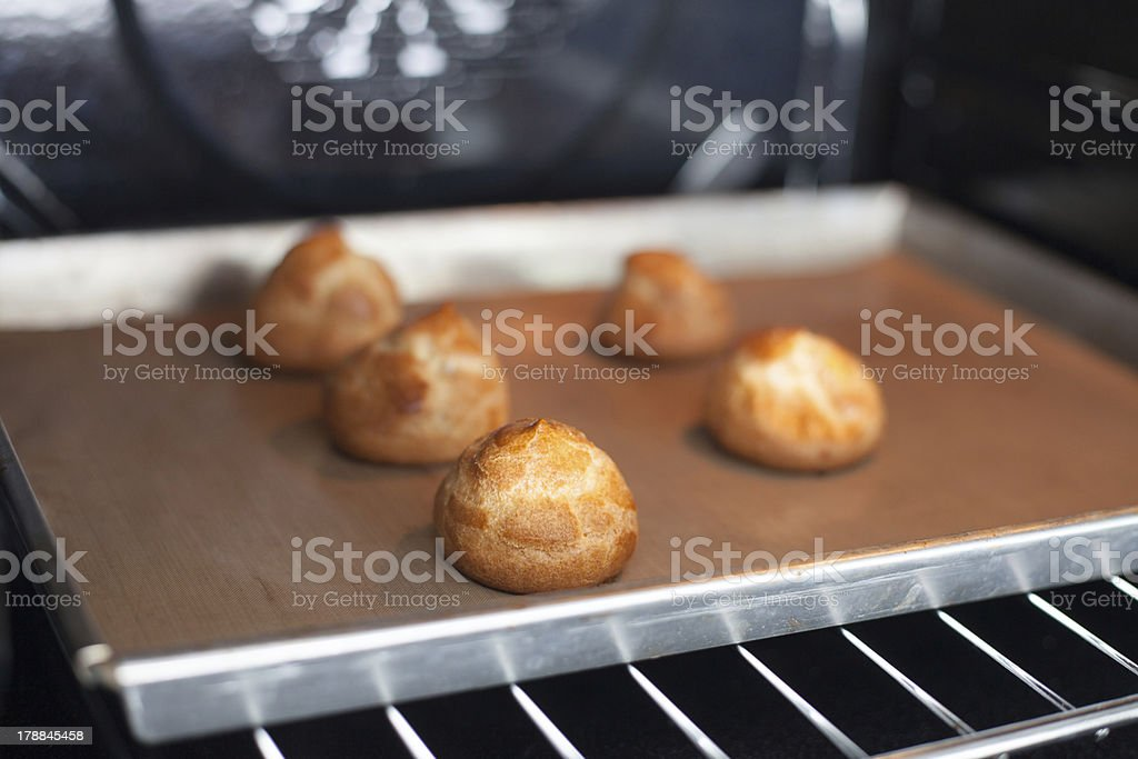 Cream puffs in the oven royalty-free stock photo