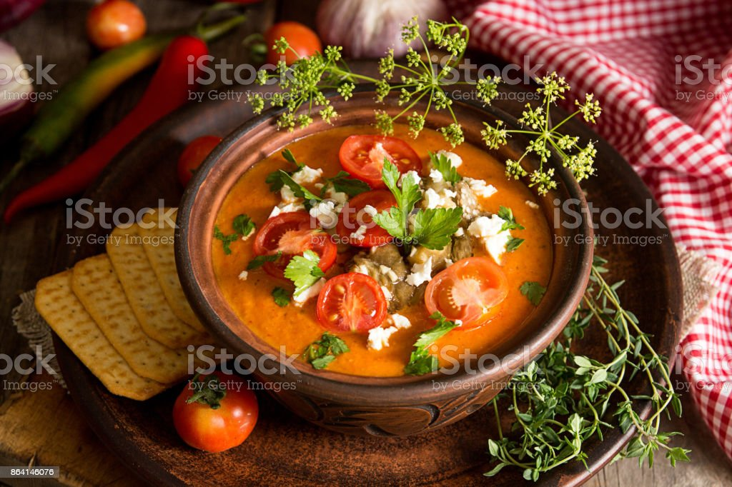 Cream puree soup from baked tomatoes, eggplants, pepper, red onion. Healthy vegetarian food. Rustic style. royalty-free stock photo