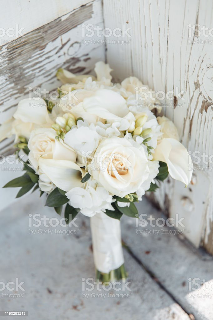 Cream Roses And White Eustpmas Arrangement Stock Photo Download Image Now Istock