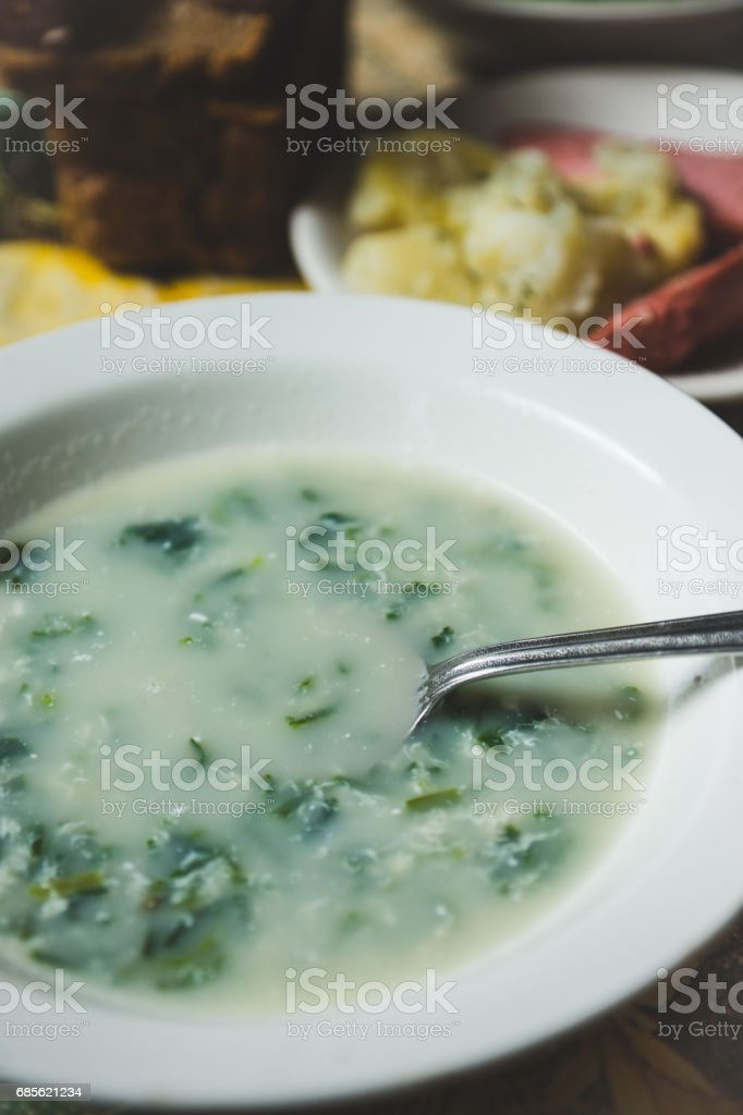 Cream soup with herbs in white plate ロイヤリティフリーストックフォト