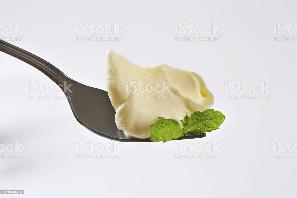 Cream spread on a fork royalty-free stock photo