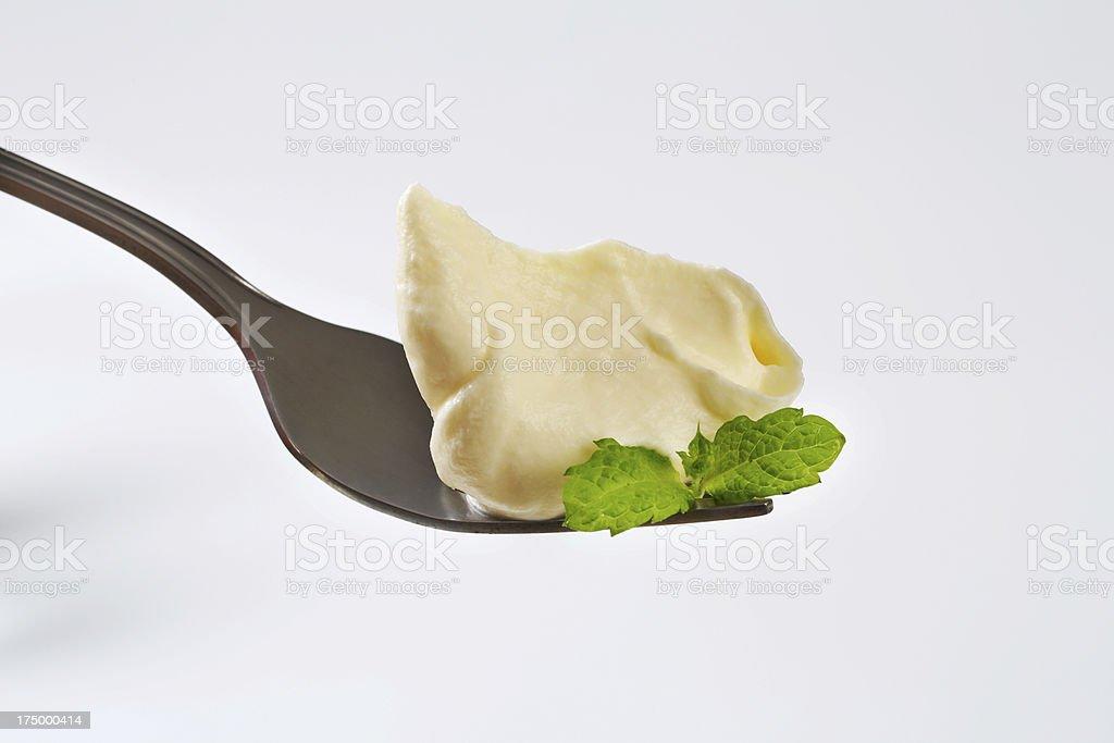 Cream spread on a fork stock photo