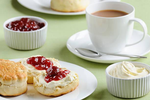 cream tea with scones, cream and jam - scone bildbanksfoton och bilder