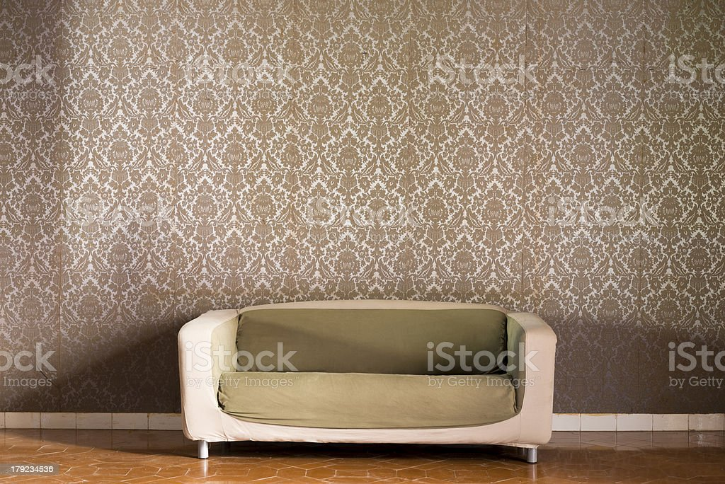 A cream/brown retro sofa sitting in the middle of a room stock photo