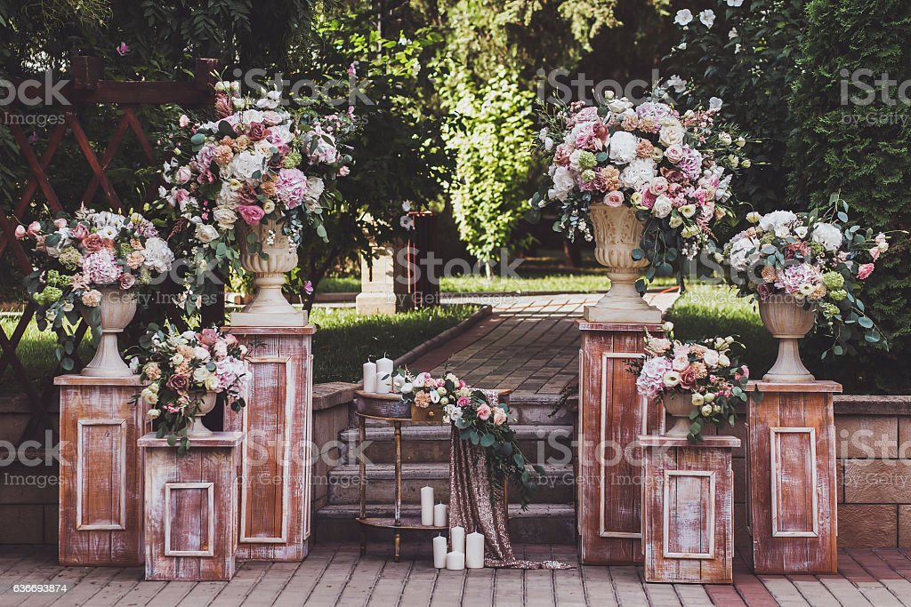 Cream-colored wedding ceremony with fresh flowers stock photo