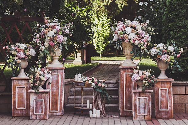cream-colored wedding ceremony with fresh flowers - retro decor stock photos and pictures