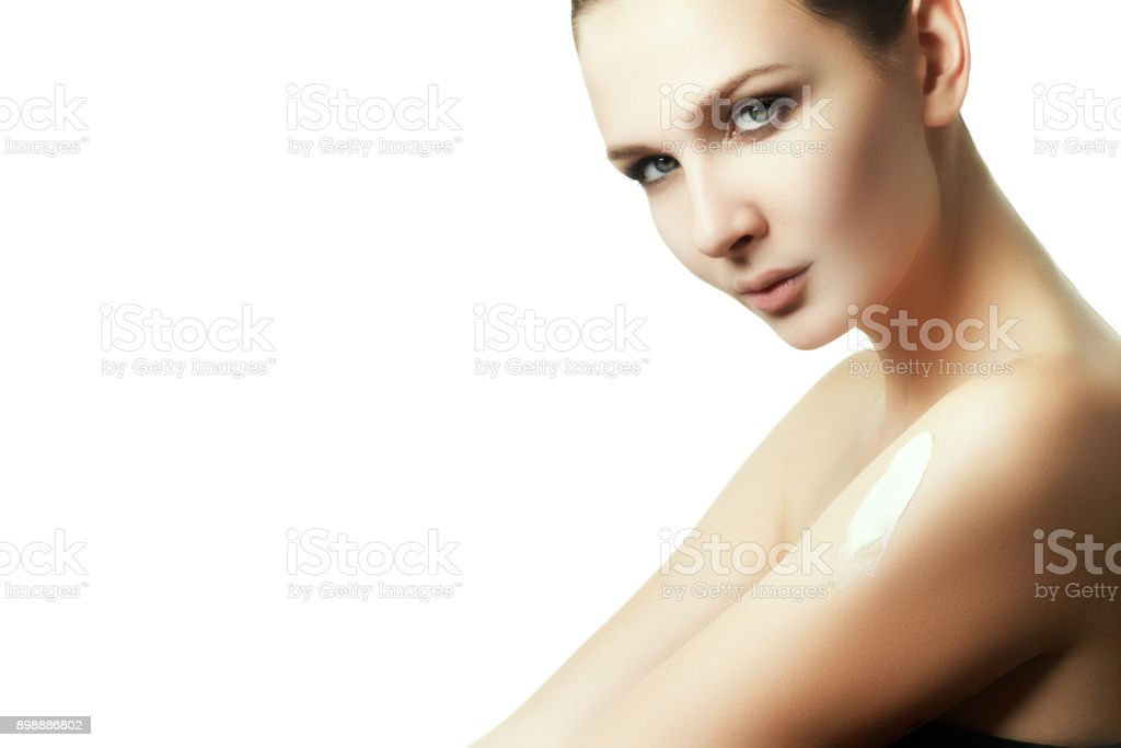 Creaming body after bathing. The woman rubbed into the skin lotion stock photo
