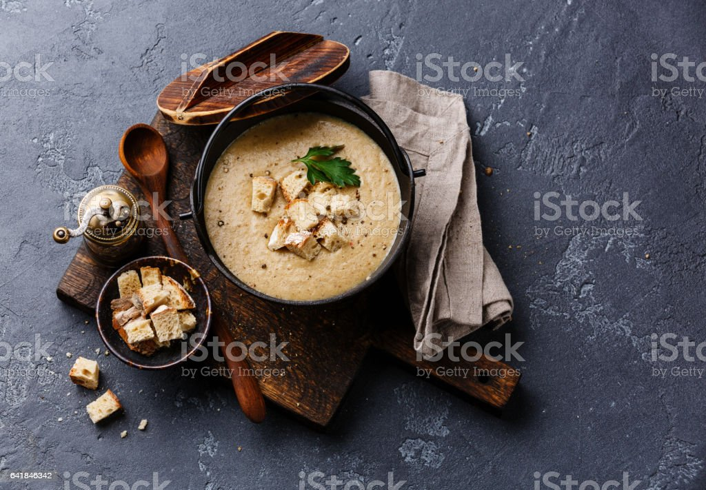 Cream-soup with porcini mushroom with croutons stock photo