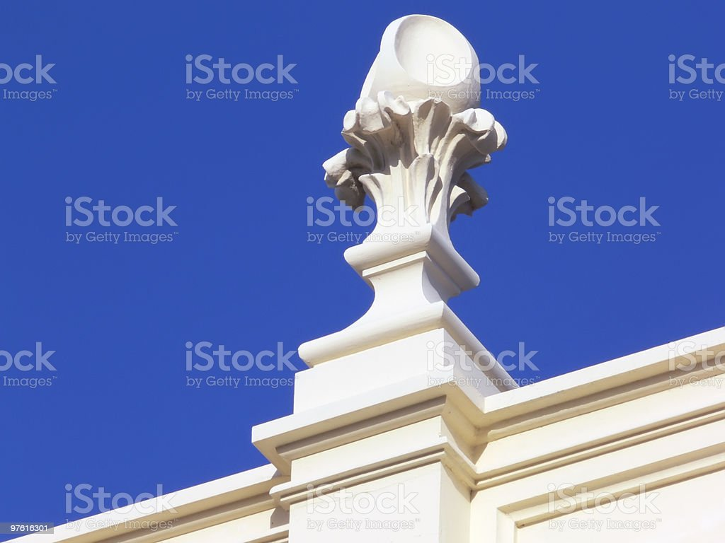 Cream-White stucco in front of deeply blue sky royalty-free stock photo