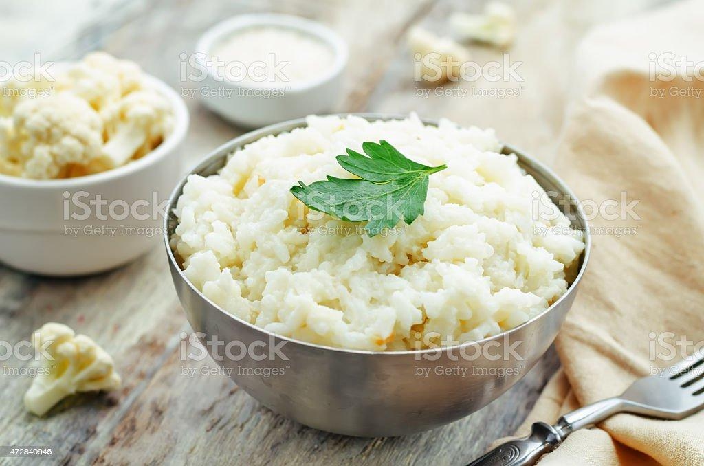 creamy cauliflower garlic rice stock photo