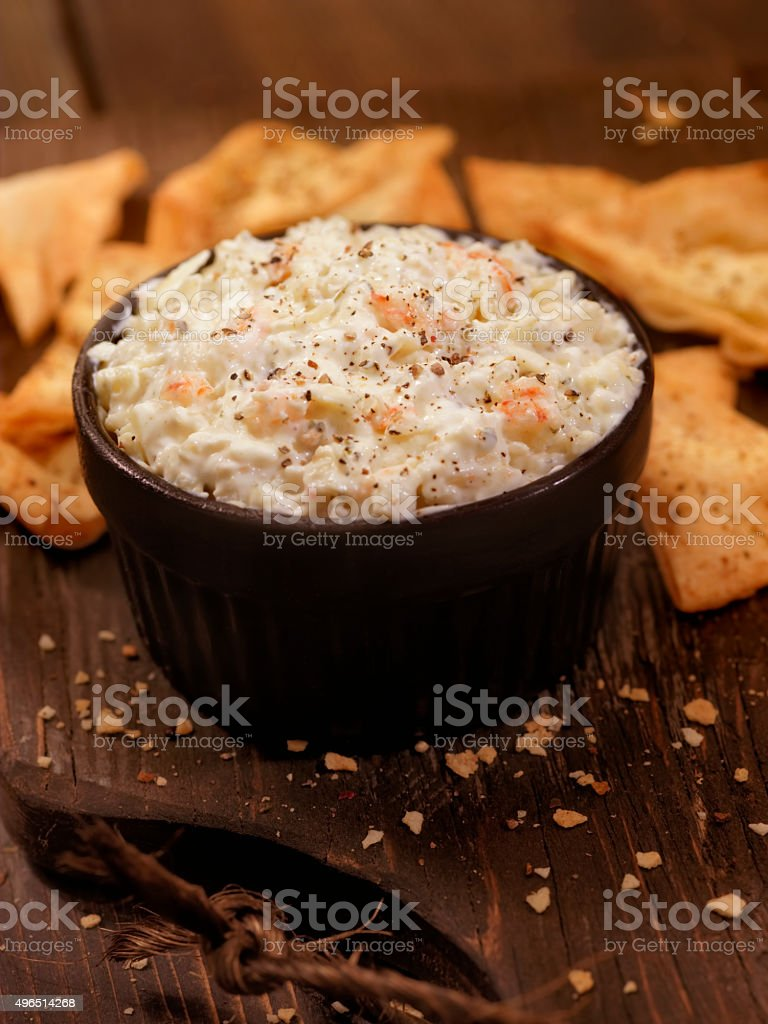 Creamy Crab Dip with Baked Pita Chips stock photo