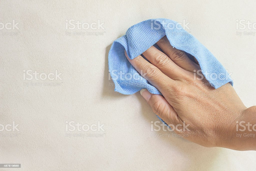 creamy fabric cleaning with a Microfiber Cloth stock photo