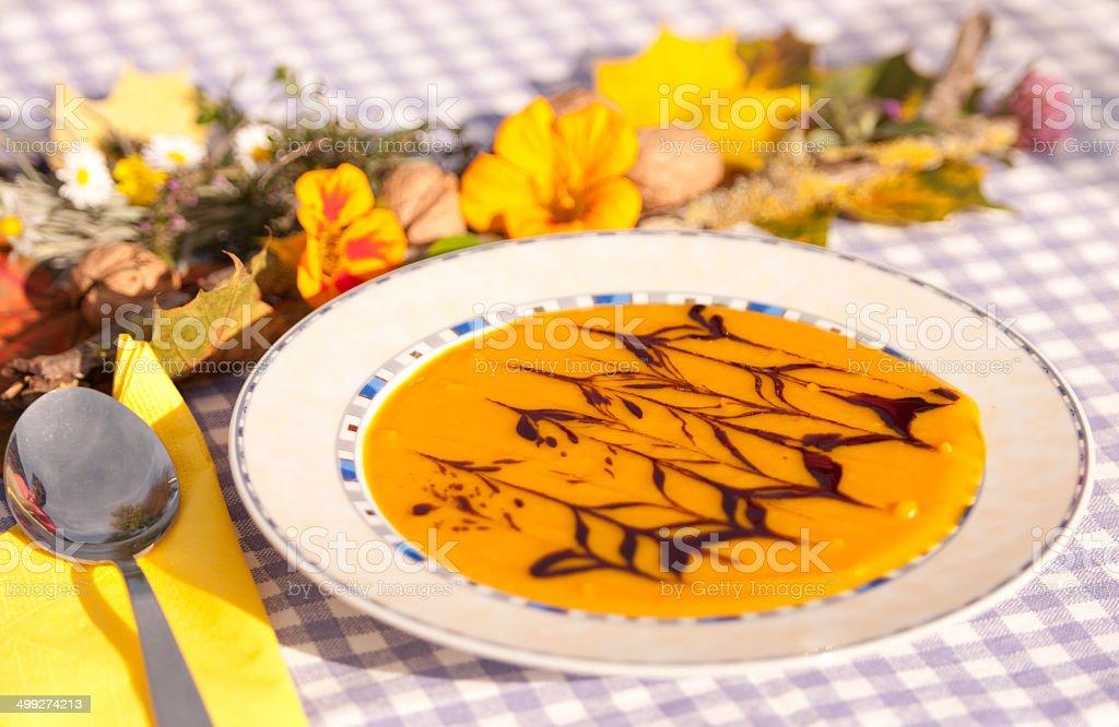 creamy hokkaido pumpkin soap on a decorated table royalty-free stock photo