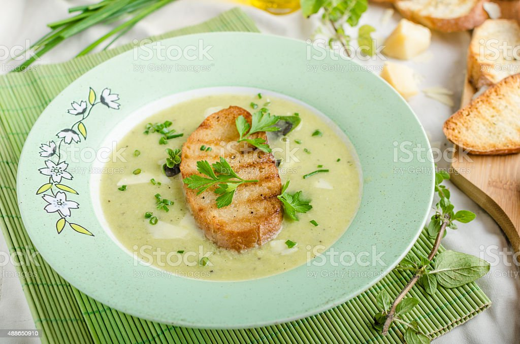 Creamy leek herby soup with toast stock photo