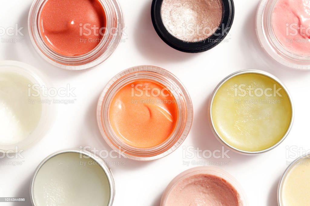 Creamy make up products - top view of decorative cosmetic containers isolated on white backgroiunds stock photo