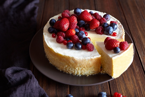 Creamy mascarpone cheese cake with strawberry and winter berries. Christmas