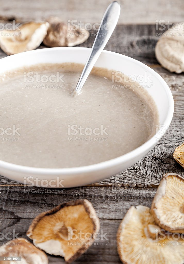 Creamy mushroom soup with champignon and shiitake stock photo