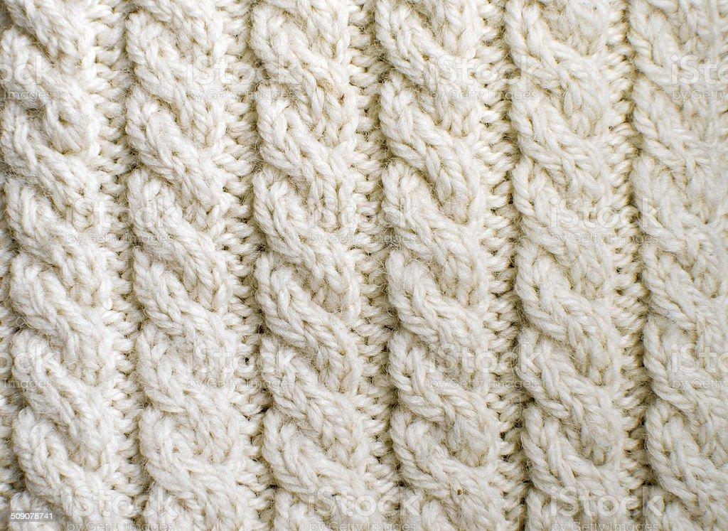 Creamy off-white wool knitwork stock photo