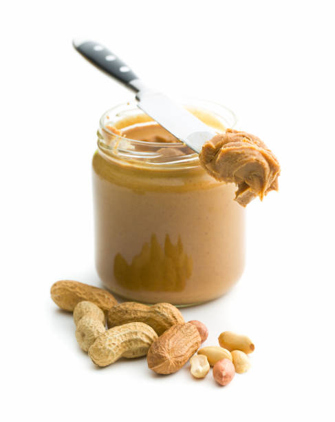 creamy peanut butter - peanut food stock photos and pictures