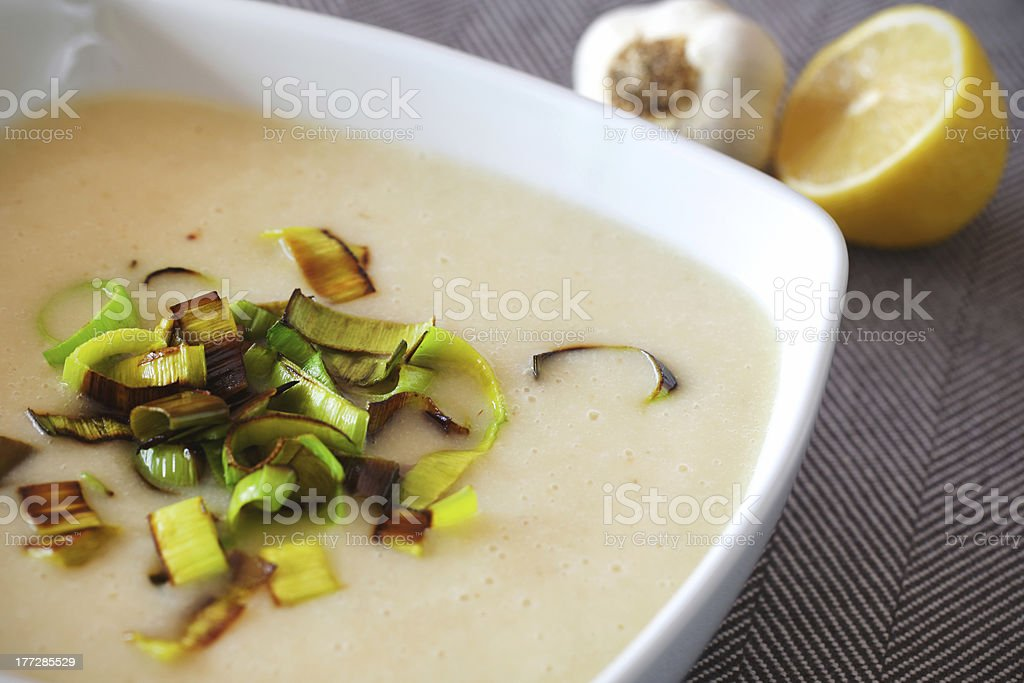 Creamy potato soup with fried leek and lemon royalty-free stock photo