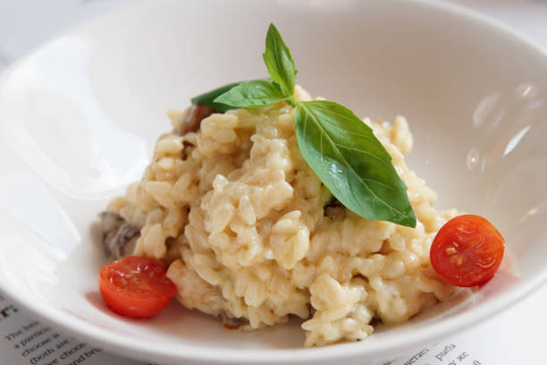Creamy risotto in porcelain plate stock photo