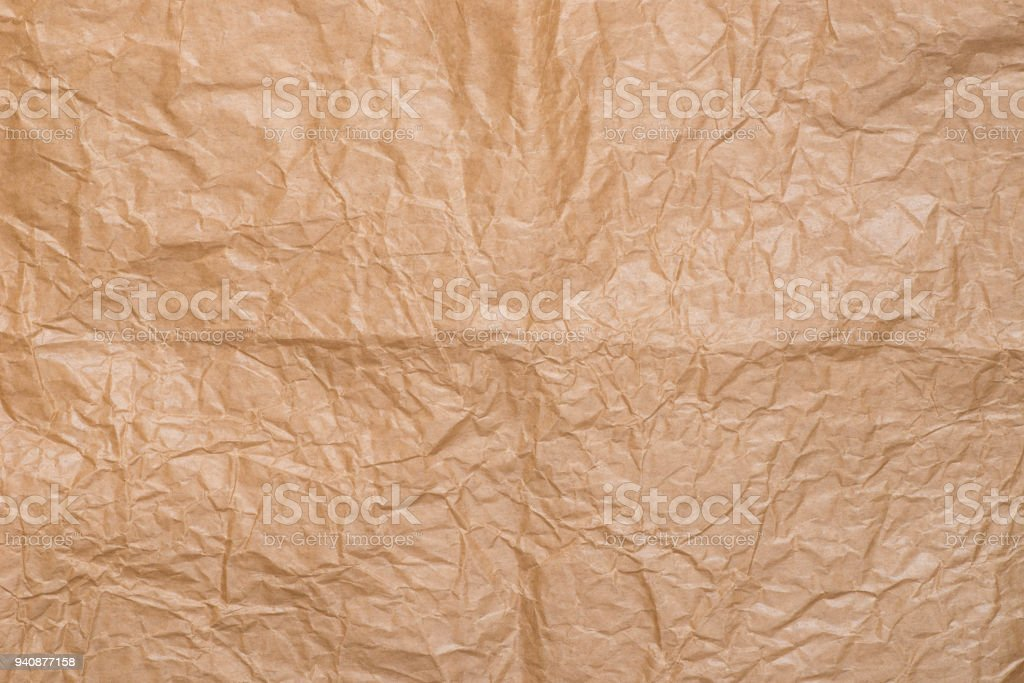 creased brown paper background stock photo