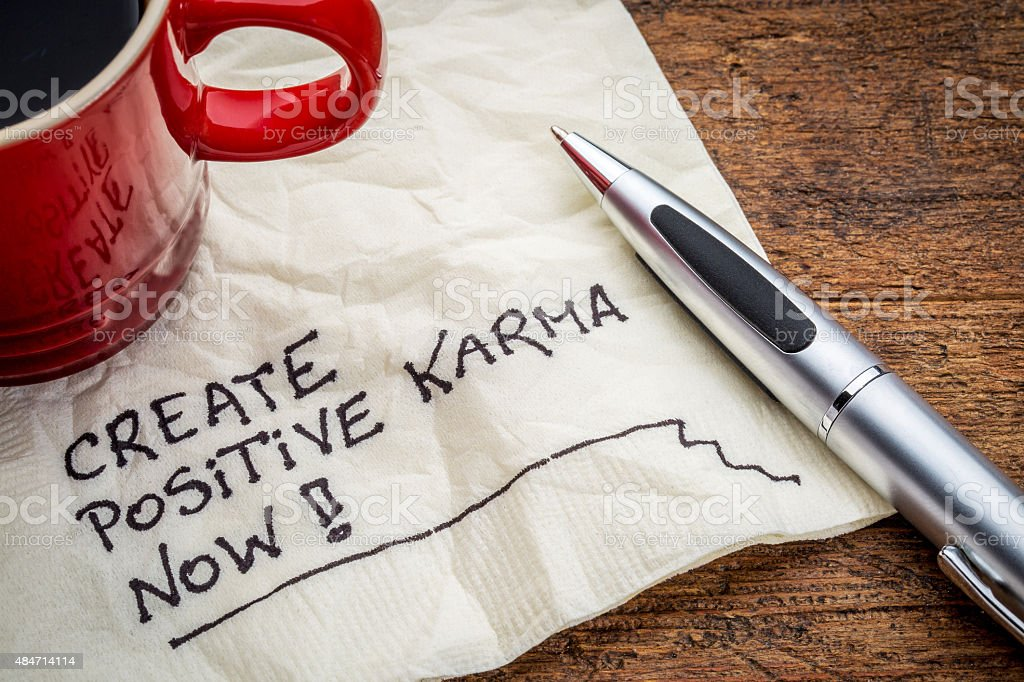 create positive karma - text on napkin stock photo