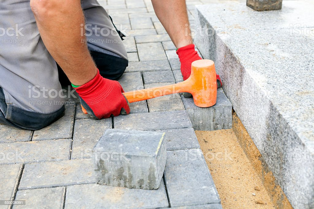 Creating a pavement. Close up. stock photo